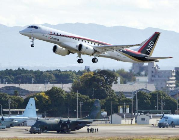 Japan's first domestically produced passenger jet, the Mitsubishi Regional Jet (MRJ), takes off from Nagoya Airport in Toyoyama, central Japan, for its first flight Wednesday morning, Nov. 11, 2015. Mitsubishi, a maker of the Zero fighter, took a step toward reclaiming Japan's one-time status as an aviation power Wednesday with the maiden flight of its regional jet. (Muneyuki Tomari/Kyodo News via AP) JAPAN OUT, CREDIT MANDATORY