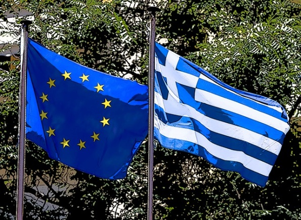 European Union flag and Greek flag, waving in the wind