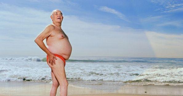 1,Mature-man-wearing-swimsuit-on-beach