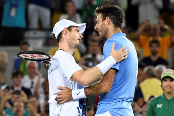 Argentina's Juan Martin Del Potro congratulates Britain's Andy Murray on winning the men's singles gold medal tennis match at the Olympic Tennis Centre of the Rio 2016 Olympic Games in Rio de Janeiro on August 14, 2016. / AFP PHOTO / Luis Acosta