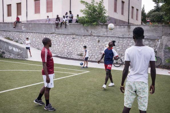 _91048429_dailyfootballmatchonthenewlyrefurbishedpitch