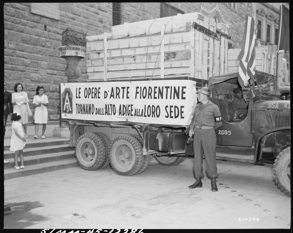 MP stands guard in front of a truck loaded with art treasures stolen by German Army and recovered by U.S. Army. The paintings are being returned to the city of Florence. 07/23/1945 111-SC-210396